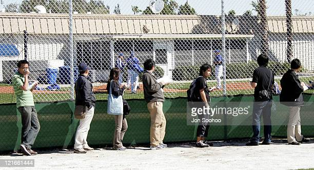 Japanese media covering the Los Angeles Dodgers' Norihiro Nakamura of Japan find time to watch Kazuhisa Ishii during workout at Dodgertown in Vero...