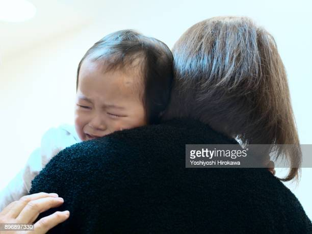 Japanese Medical System at clinic,Mother holding a crying child