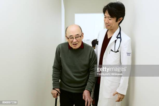 Japanese Medical System in cardiovascular clinic.The doctor talking to the patient coming from the examination room.
