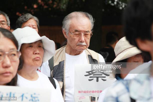 Japanese members of the KobeNanjing HeartToHeart Association take part in the 2017 Nanjing international peaceful assembly to mark the 72nd...
