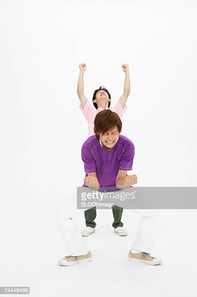 Japanese men celebrating