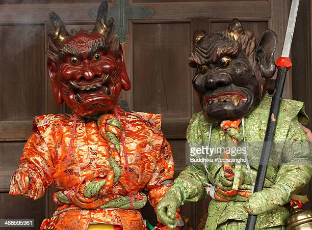 Japanese men dressed in traditional costume as Aka Oni red devil AoOni blue devil perform a ritualistic dance during the Oni Oi annual festival at...