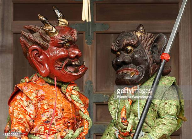 Japanese men dressed in traditional costume as AkaOni red devil AoOni blue devil perform a ritualistic dance during the Oni Oi annual festival at...
