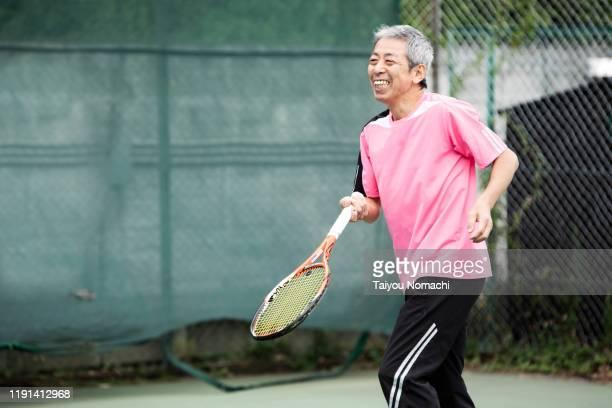 japanese men enjoying tennis - スポーツ施設 ストックフォトと画像