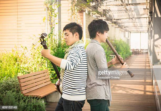 japanese men playing the shamisen and the shakuhac - bamboo flute stock photos and pictures