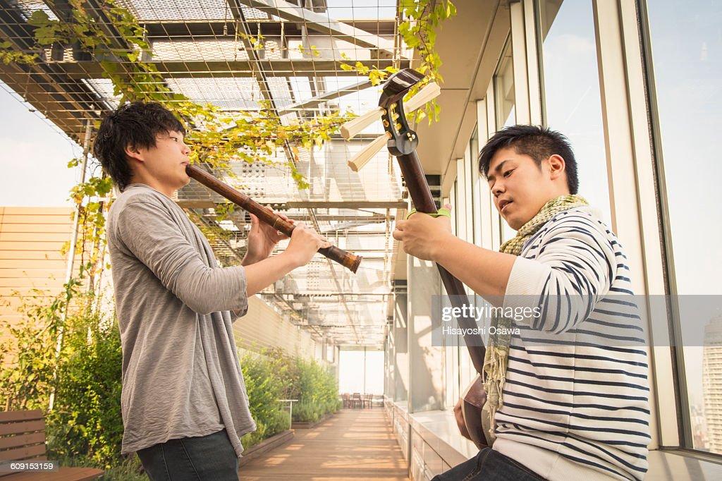 Japanese men playing the shamisen and the shakuhac : Stock Photo
