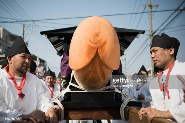 Japanese men seen carrying a replica of a phallus during the festival Honen festival is a traditional famous festival in Tagata Jinja Shrine komaki...