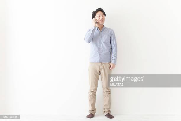 japanese men who call - チノパンツ ストックフォトと画像