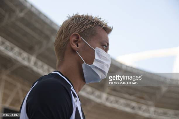 Japanese midfielder Keisuke Honda takes part in a training session while wearing a protective face mask to prevent the spread of the new Coronavirus...