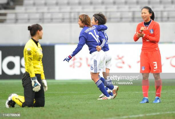 Japanese midfielder Mami Yamaguchi celebrates with her teammate Aya Miyama just after scoring a goal beside South Korean goalkeeper Kim JungMi and...