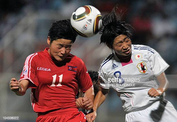 Japanese midfielder Yoko Tanaka vies for the ball with North Korean forward Su Gyong Kim during the FIFA Women's Under-17 semifinal match on...