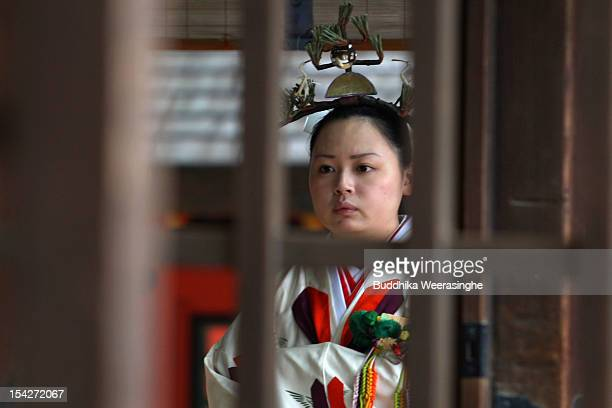 Japanese Miko shrine maiden attends a ceremony to present an offering of the first harvest of sacred rice during the TakaraNoIchi ceremony at...
