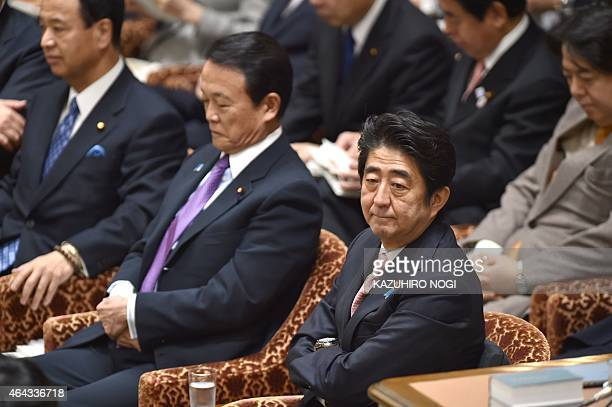 Japanese Minister Shinzo Abe and his cabinet members attend a budget committee session of the House of Representatives at Parliament in Tokyo on...