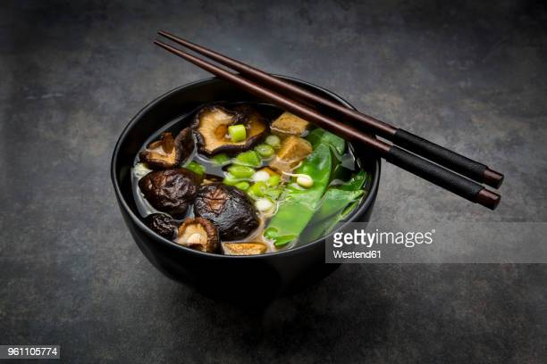 Japanese miso soup with sugar peas, shitake mushrooms, tofu and mung sprouts