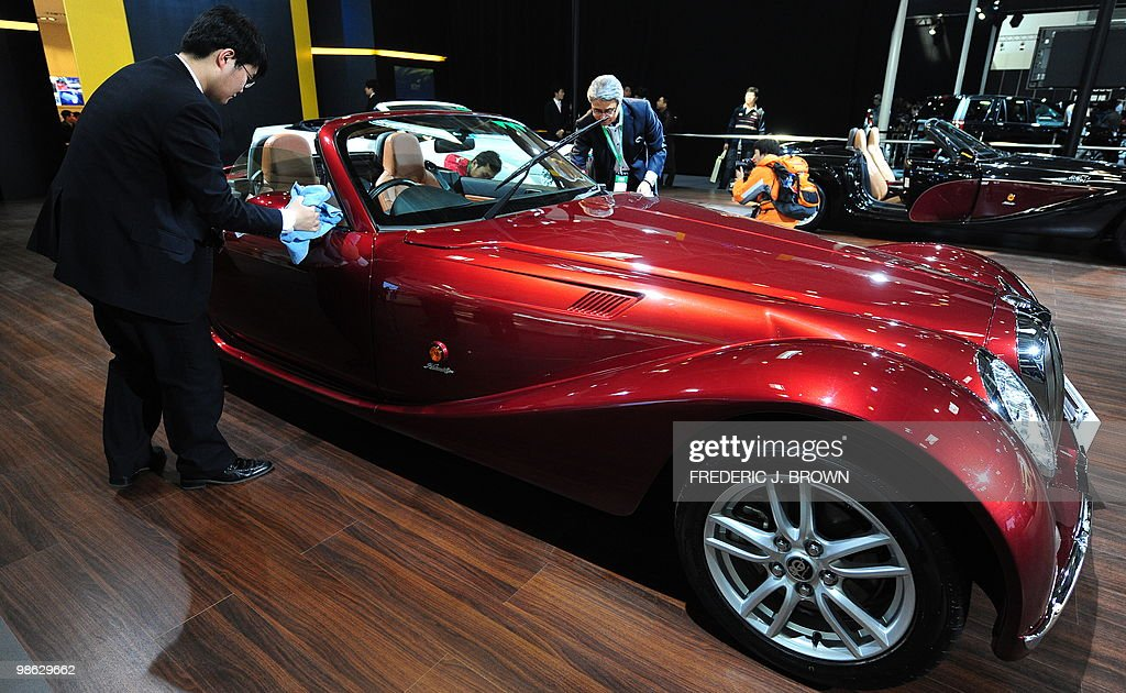 A Japanese Mitsuoka Himiko car is wiped shiny clean for display during a media preview at the Beiijng Auto Show on April 23, 2010. Auto sales in booming China hit 13.64 million in 2009, overtaking the United States, as increasingly well-off Chinese consumers continued to snap up cars, helped by government incentives such as lower taxes. AFP PHOTO/Frederic J. BROWN