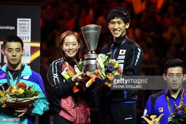 Japanese mixed double Maharu Yoshimura and Kasumi Ishikawa celebrate with the trophy after winning the World Championship title against Taiwan´s Chen...