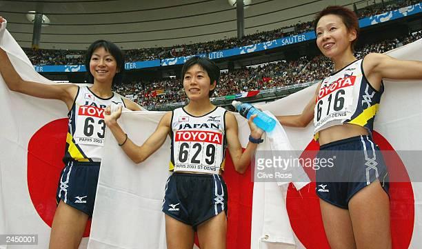 Japanese Mizuki Noguchi Naoko Sakamoto and Masako Chiba celebrate after they finished the women's marathon final at the 9th IAAF World Athletics...