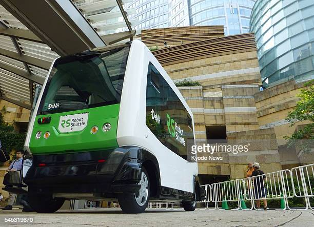 Japanese mobile internet company DeNA Co shows its electric driverless bus produced by EasyMile a French driverless technology startup in Tokyo on...