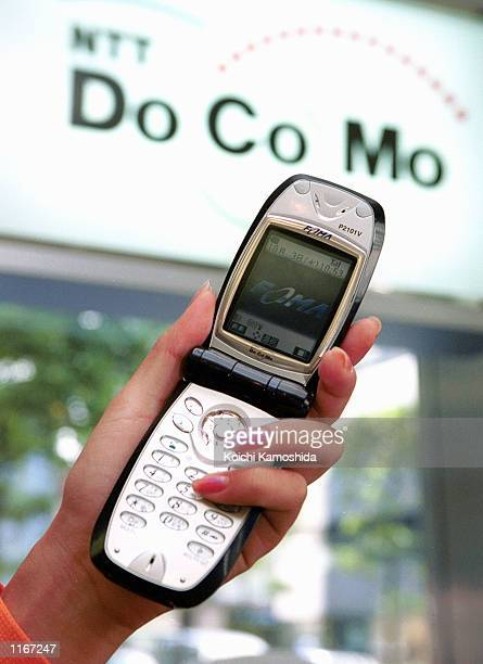 Japanese mobile operator DoCoMo introduces a new mobile phone named Freedom of Mobile Multimedia Access October 3 2001 in Tokyo