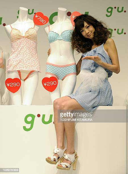 Japanese model Aki Hoshino introduces her selections of 'GU lingerie collection' during a photo session at its press preview in Tokyo on February 9...