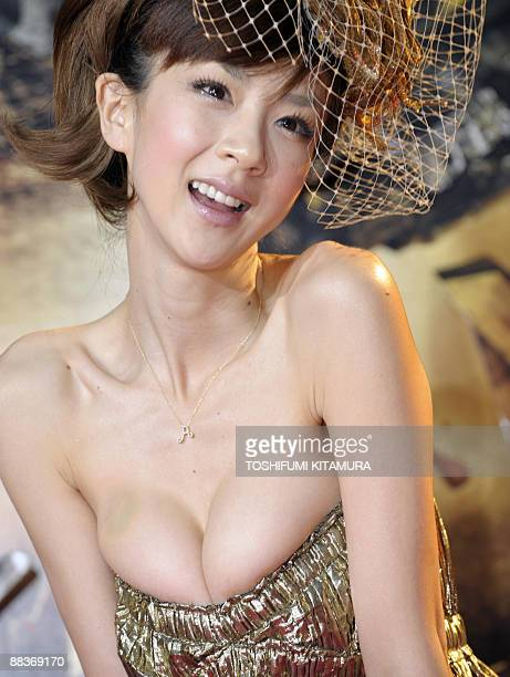 Japanese model Aki Hoshino poses for photographers on the red carpet of the 'Transformers Revenge of the Fallen' world premiere in Tokyo on June 8...