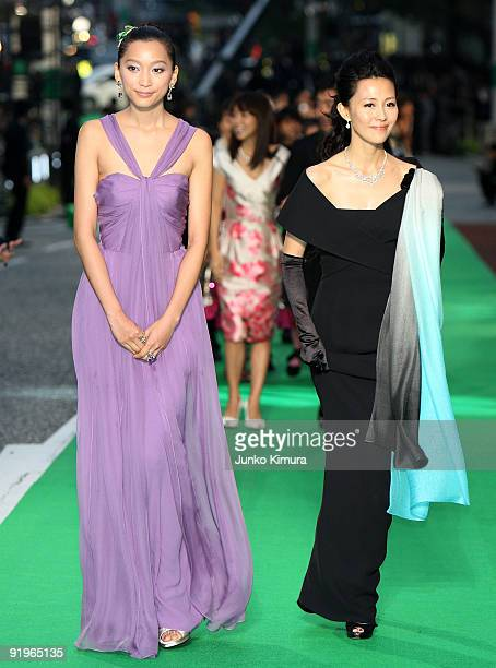 Japanese Model Anne and actress Yoshino Kimura walk on the green carpet during the 22nd Tokyo International Film Festival Opening Ceremony at...
