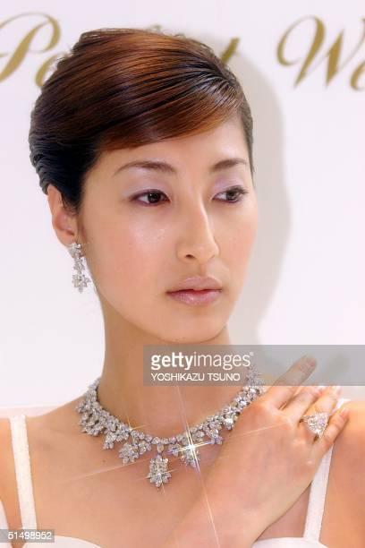 Japanese model Mariko wears a 15456karat diamond necklace and 1741karat pair shaped diamond ring total priced 413 million yen for the promotion of...