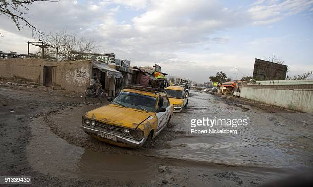 A japanese model taxi negotiates deep potholes in downtown Kabul Afghanistan April 17 2009