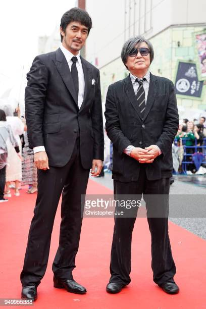 Japanese model/actor Hiroshi Abe and Japanese film director Yasuo Tsuruhashi attend the Okinawa International Film Festival on April 22, 2018 in...