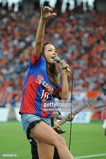Japanese modelAnna Tsuchiya sings a song before the J League match between FC Tokyo and Shimizu SPulse at Ajinomoto Stadium on August 2 2014 in Chofu...