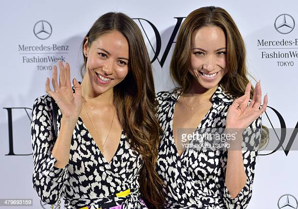 Japanese models Jessica Michibata and her sister Angelica Michibata smile after designer Diane von Furstenberg's presentative of her 20142015...