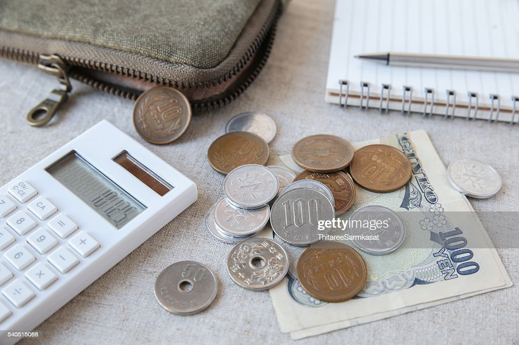 Japanese money Yen wtih calculator, notebook and pouch : Stock Photo