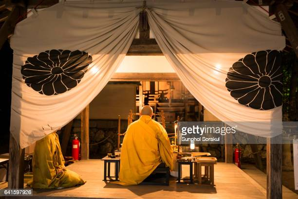 A japanese Monk chanting during the moon viewing festival