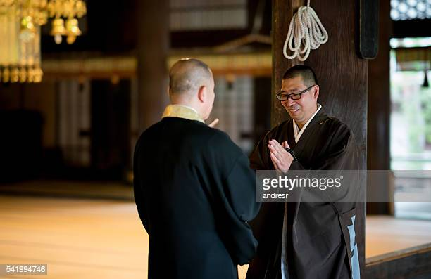Japanese monks greeting each other
