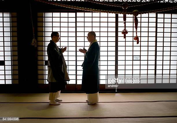 Japanese monks talking at a temple