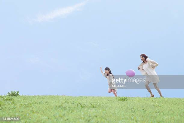 Japanese mother and child playing on the lawn