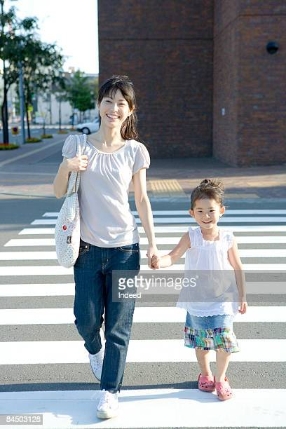 Japanese mother and daughter crossing road