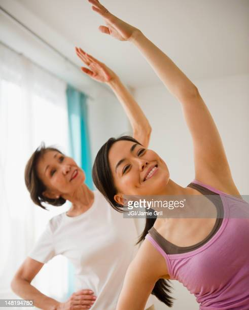 Japanese mother and daughter exercising together