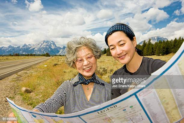 Japanese mother and daughter looking at map