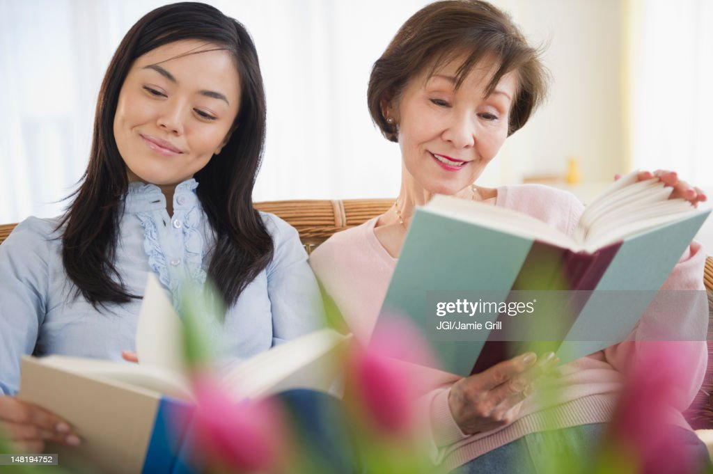 Japanese mother and daughter reading books : Stock Photo