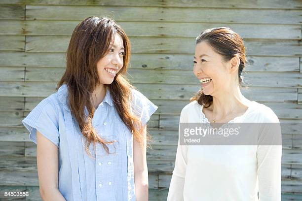 japanese mother and daughter smiling face to face - japanese mom stock photos and pictures