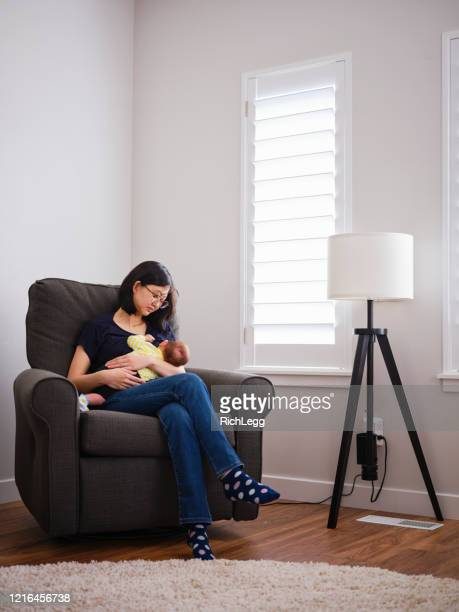 japanese mother breastfeeding her baby - japanese breastfeeding stock pictures, royalty-free photos & images