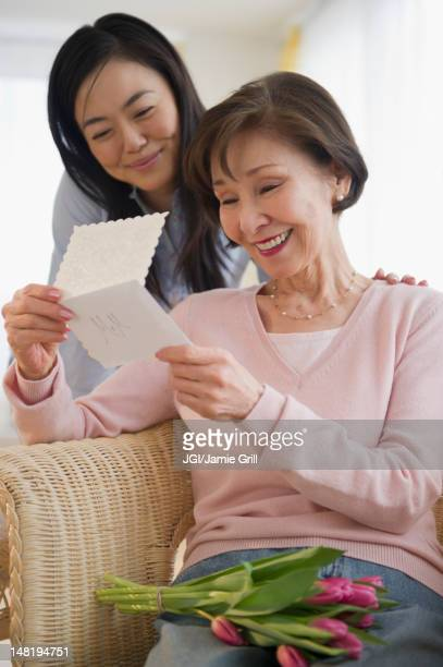 japanese mother reading card from daughter - mothers day card stock pictures, royalty-free photos & images