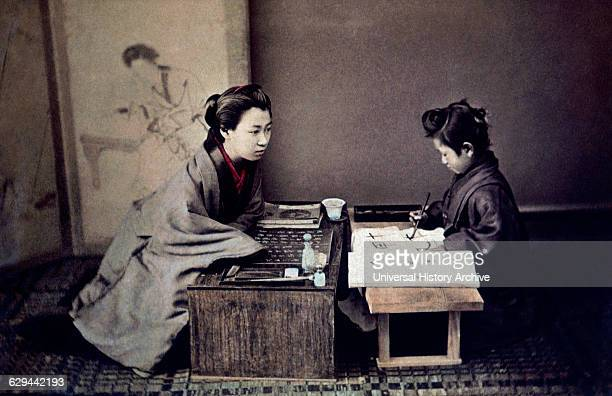 Japanese Mother Teaching Child Calligraphy circa 1890