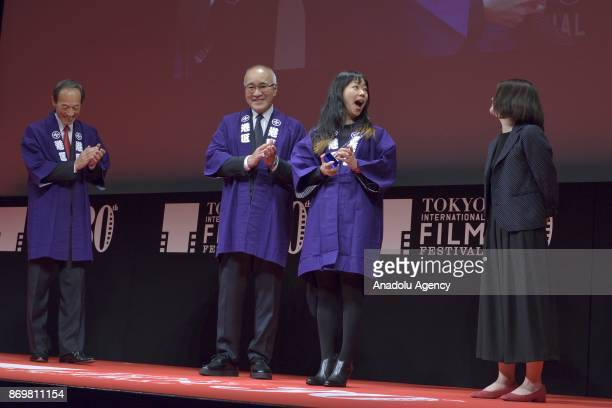 Japanese movie director Akiko Oku winner the Audience Award for the movie 'Tremble All You Want' during the closing ceremony of the Tokyo...