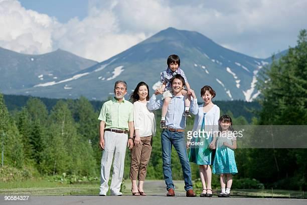 Japanese multi-generational family smiling