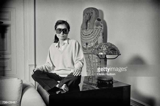 Japanese multimedia artist singer and songwriter Yoko Ono in the lounge of the apartment she shared with John Lennon one year to the day after he was...