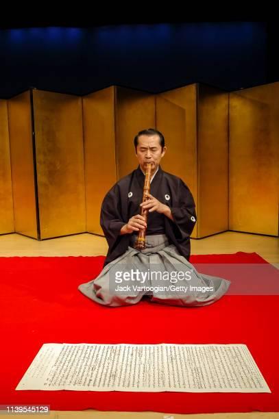 Japanese musician Kifu Mitsuhashi plays shakuhachi as he performs with his ensemble at the Japan Society New York New York May 13 2003