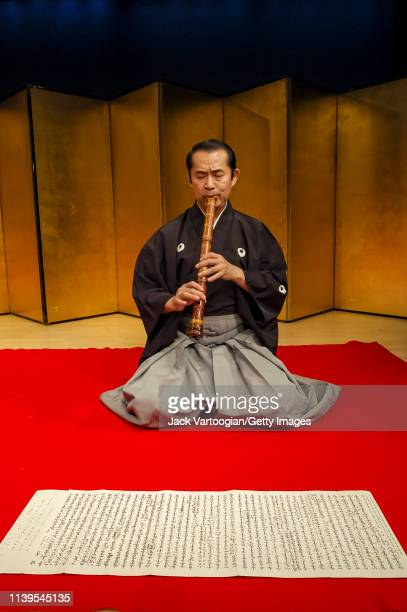 Japanese musician Kifu Mitsuhashi plays shakuhachi as he performs with his ensemble at the Japan Society New York New York May 13 2003