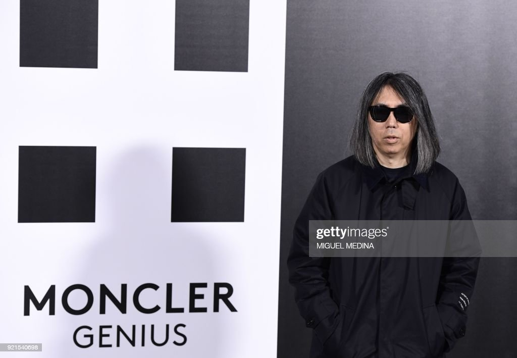 Japanese musician, producer and designer Hiroshi Fujiwara poses upon his arrival to the women's Fall/Winter 2018/2019 collection fashion show by Moncler in Milan, on February 20, 2018. / AFP PHOTO / Miguel MEDINA